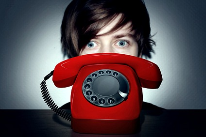 woman staring at red phone